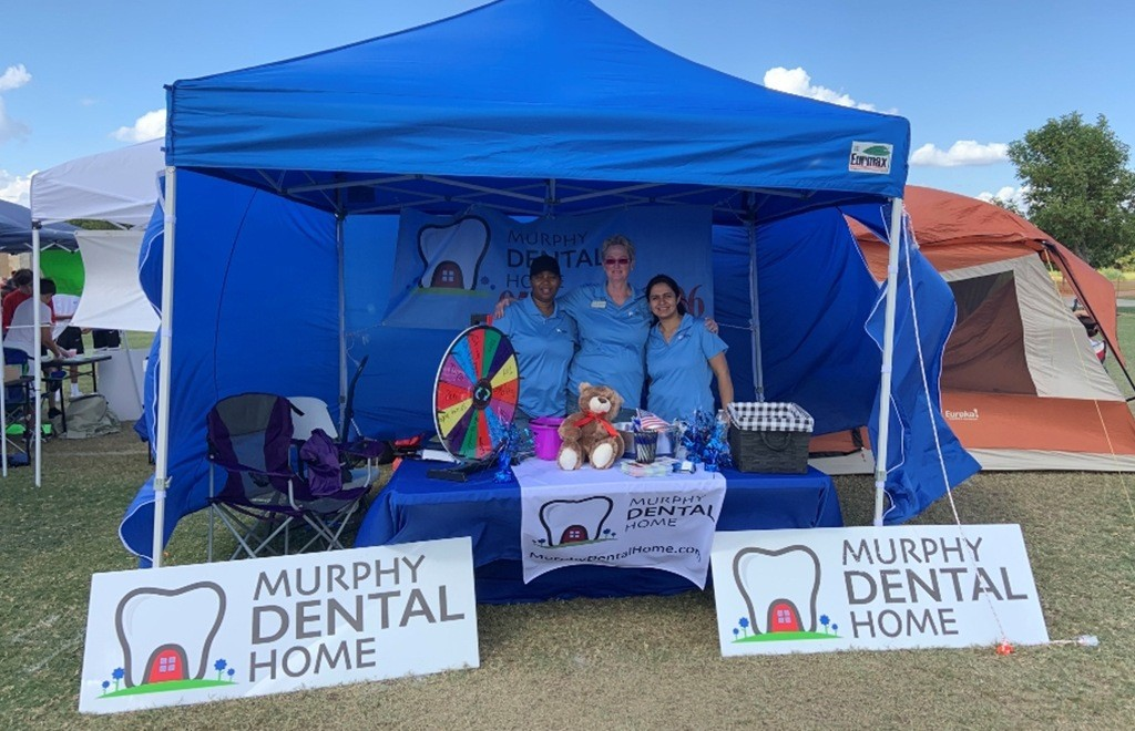 Three dental team members at community event