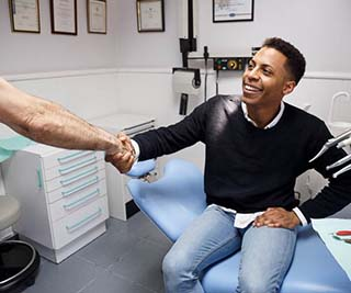 Young man with missing front tooth