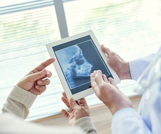 X-Ray of jaw and skull bone on tablet computer